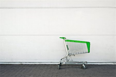 empty shopping cart - Empty Shopping Cart parked in front of large supermarket. Consumerism concept. Stock Photo - Budget Royalty-Free & Subscription, Code: 400-07621815