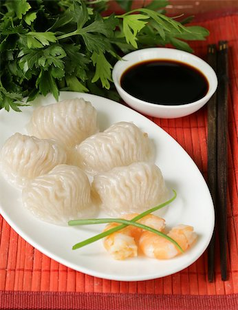dumplings steamer - Asian steamed meat dumplings dim sum with soy sauce Stock Photo - Budget Royalty-Free & Subscription, Code: 400-07622560