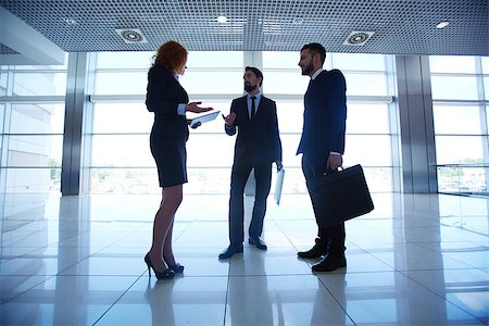 pressmaster (artist) - Group of three white collar workers interacting on background of office window Stock Photo - Budget Royalty-Free & Subscription, Code: 400-07632401