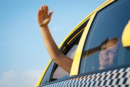 diego_cervo (artist) - people travelling. Female passenger in taxi with arm outside of car window waving hand. Concept of freedom Stock Photo - Budget Royalty-Free & Subscription, Code: 400-07633250