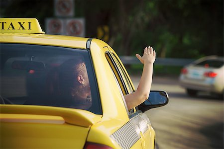diego_cervo (artist) - people travelling. Female passenger in taxi with arm outside of car window waving hand. Concept of freedom Stock Photo - Budget Royalty-Free & Subscription, Code: 400-07633253