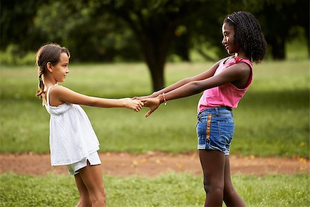 diego_cervo (artist) - Two hispanic and african little girls playing ring around the rosie in public park and holding hands Stock Photo - Budget Royalty-Free & Subscription, Code: 400-07633926