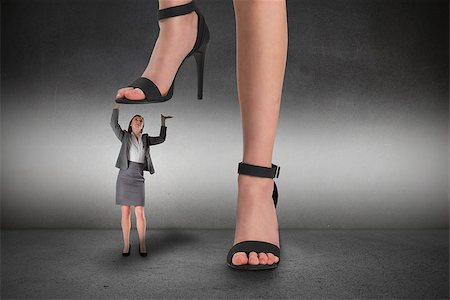 Composite image of female feet in black sandals standing on businesswoman Stock Photo - Budget Royalty-Free & Subscription, Code: 400-07665422