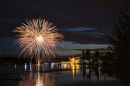 silhouette of firework - Fireworks on the riverfront Ticino in a summer night, Sesto Calende - Varese, Italy Stock Photo - Budget Royalty-Free & Subscription, Code: 400-07675575