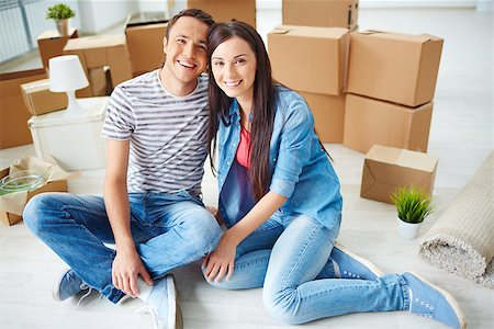 pressmaster (artist) - Happy young couple sitting on the floor of new house and looking at camera Stock Photo - Budget Royalty-Free & Subscription, Code: 400-07678139