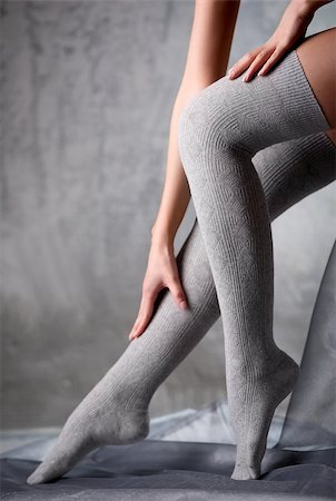 stocking feet - Beautiful woman legs in grey stockings Stock Photo - Budget Royalty-Free & Subscription, Code: 400-07678907