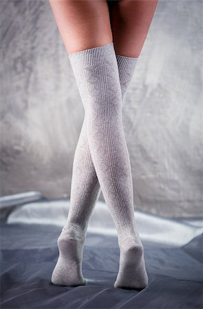 stocking feet - Beautiful woman legs in cotton stockings Stock Photo - Budget Royalty-Free & Subscription, Code: 400-07678910
