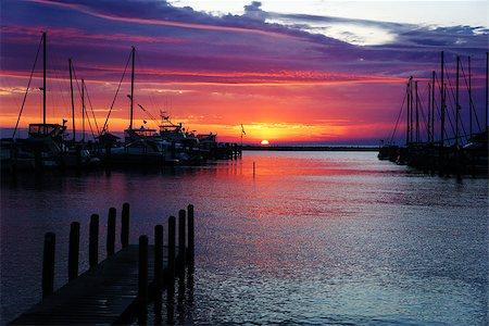 Image of a beautiful sunset at boat marina Stock Photo - Budget Royalty-Free & Subscription, Code: 400-07680821