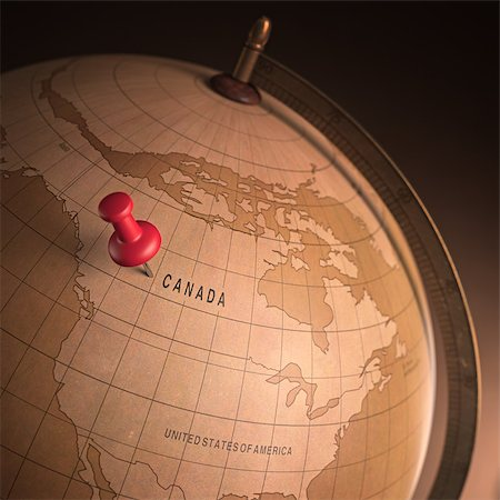 Antique globe with the Canada marked by the pin. Clipping path included. Stock Photo - Budget Royalty-Free & Subscription, Code: 400-07681816