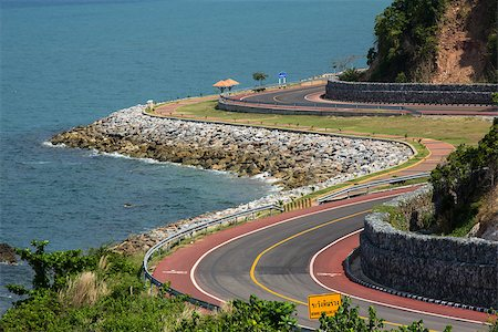 road landscape - Winding road by the sea in Chanthaburi, Thailand Stock Photo - Budget Royalty-Free & Subscription, Code: 400-07682705