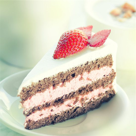 Slice of strawberry chocolate cake, in vintage retro toned with noise. Stock Photo - Royalty-Free, Artist: szefei, Image code: 400-07715204