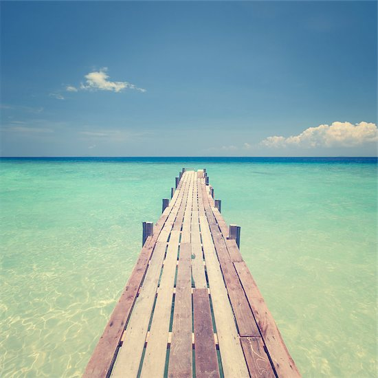 Pier wooden bridge towards sea, tropical island sea view in vintage style. Stock Photo - Royalty-Free, Artist: szefei, Image code: 400-07715202