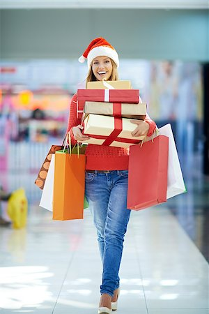 pressmaster (artist) - Woman with gift boxes in the mall Stock Photo - Budget Royalty-Free & Subscription, Code: 400-07715239