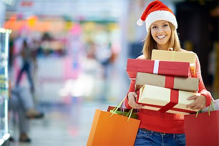 pressmaster (artist) - Portrait of young woman with gift boxes Stock Photo - Budget Royalty-Free & Subscription, Code: 400-07715240