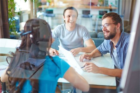 pressmaster (artist) - Young business partners discussing ideas or project at meeting in office Stock Photo - Budget Royalty-Free & Subscription, Code: 400-07715263