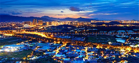 Famed skyline of Hong Kong  Yuen Long downtown sunset Stock Photo - Budget Royalty-Free & Subscription, Code: 400-07716711
