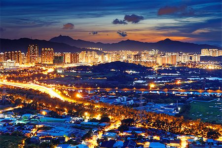 Famed skyline of Hong Kong  Yuen Long downtown sunset Stock Photo - Budget Royalty-Free & Subscription, Code: 400-07716712