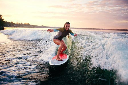 pressmaster (artist) - Young woman surfboarding at summer resort Stock Photo - Budget Royalty-Free & Subscription, Code: 400-07729202
