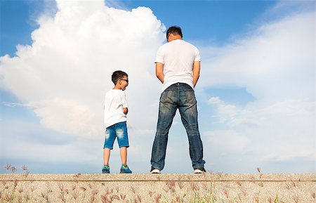father and son standing on a stone platform and pee together Stock Photo - Budget Royalty-Free & Subscription, Code: 400-07720000