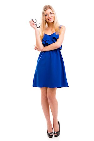 Beautiful fashion woman wearing a blue dress, isolated over white background Stock Photo - Budget Royalty-Free & Subscription, Code: 400-07747943