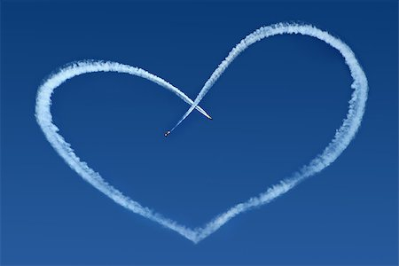 fly heart - Airplanes Skywriting a Heart on blue sky Stock Photo - Budget Royalty-Free & Subscription, Code: 400-07748277