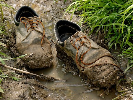 muddy worn out shoes in the puddle Stock Photo - Budget Royalty-Free & Subscription, Code: 400-07817520