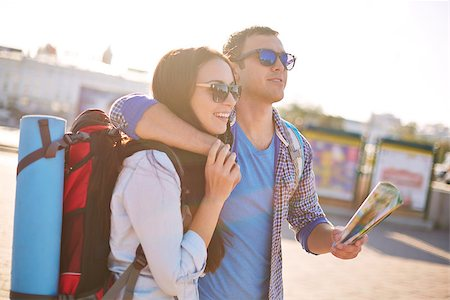 pressmaster (artist) - Young travelers with map traveling in a city Stock Photo - Budget Royalty-Free & Subscription, Code: 400-07818569