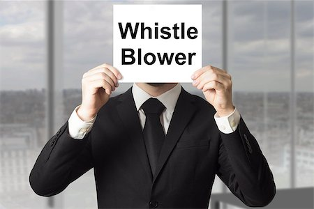 businessman in black suit hiding face behind sign whistle blower Stock Photo - Budget Royalty-Free & Subscription, Code: 400-07894805