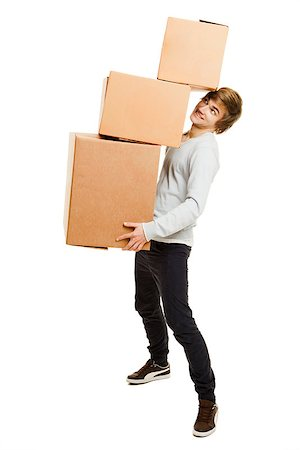 Portrait of a handsome young man holding card boxes, isolated on white Stock Photo - Budget Royalty-Free & Subscription, Code: 400-07897647