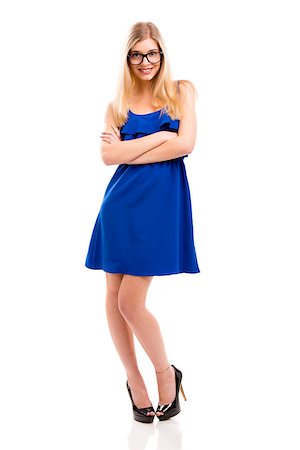 Beautiful fashion woman in blue dress using nerd glasses, isolated over white background Stock Photo - Budget Royalty-Free & Subscription, Code: 400-07898816