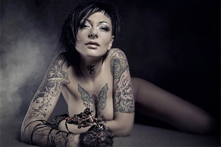 Beautiful woman with many tattoos posing indoors Stock Photo - Budget Royalty-Free & Subscription, Code: 400-07892252