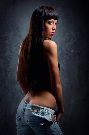 Young sensual woman in jeans Stock Photo - Budget Royalty-Free & Subscription, Code: 400-07892315