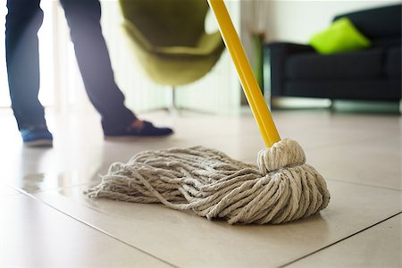 diego_cervo (artist) - Woman at home, doing chores and housekeeping, wiping floor with water in living room. Focus on floor and mop Stock Photo - Budget Royalty-Free & Subscription, Code: 400-07903311