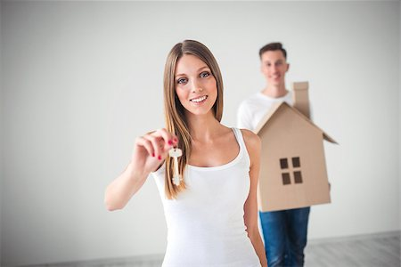 Couple with the keys of new house Stock Photo - Budget Royalty-Free & Subscription, Code: 400-07916993
