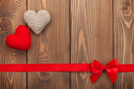 Valentines day background with toy hearts, red ribbon and copy space Stock Photo - Budget Royalty-Free & Subscription, Code: 400-07919378