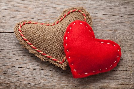 Valentines day toy hearts over wooden background Stock Photo - Budget Royalty-Free & Subscription, Code: 400-07919384