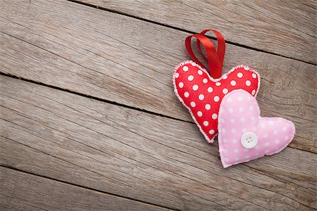 Valentines day background with toy hearts and copy space Stock Photo - Budget Royalty-Free & Subscription, Code: 400-07919385