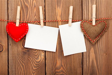 Photo frames and valentines toy hearts over wooden background Stock Photo - Budget Royalty-Free & Subscription, Code: 400-07925284