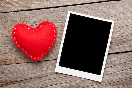 Photo frame and valentines toy heart over wooden table background Stock Photo - Budget Royalty-Free & Subscription, Code: 400-07925289