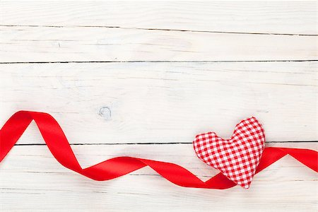 Valentines day toy heart and ribbon over wooden table background with copy space Stock Photo - Budget Royalty-Free & Subscription, Code: 400-07925299