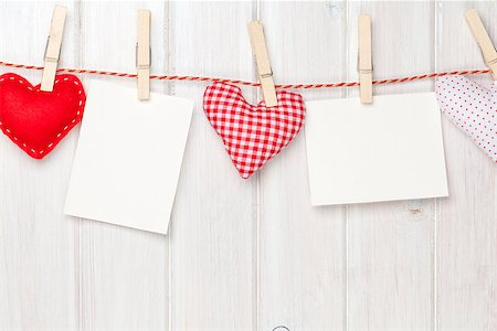 Photo frames and valentines toy hearts over wooden background Stock Photo - Budget Royalty-Free & Subscription, Code: 400-07925324