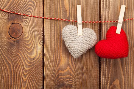 Handmaded toy valentines hearts on rope over wooden background with copy space Stock Photo - Budget Royalty-Free & Subscription, Code: 400-07922846