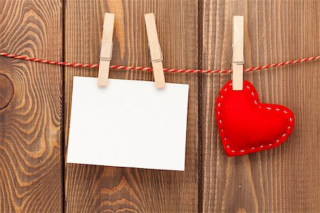 Photo frame and handmaded valentines day toy heart over wooden background Stock Photo - Budget Royalty-Free & Subscription, Code: 400-07933757