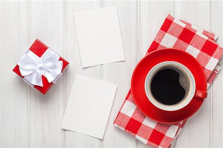 Valentines day blank photo frames, coffee cup and gift box over white wooden table Stock Photo - Budget Royalty-Free & Subscription, Code: 400-07933786