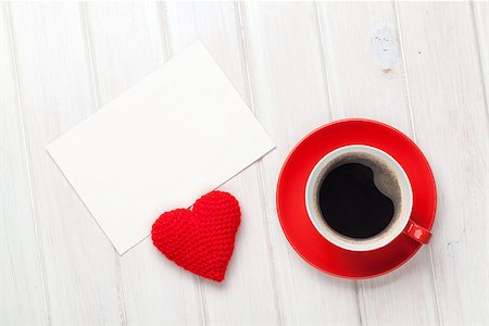 Valentines day blank greeting card, coffee cup and heart shaped toy over white wooden table Stock Photo - Budget Royalty-Free & Subscription, Code: 400-07933984