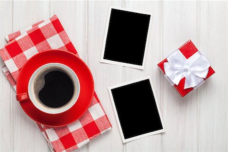 Valentines day blank photo frames, coffee cup and gift box over white wooden table Stock Photo - Budget Royalty-Free & Subscription, Code: 400-07933985