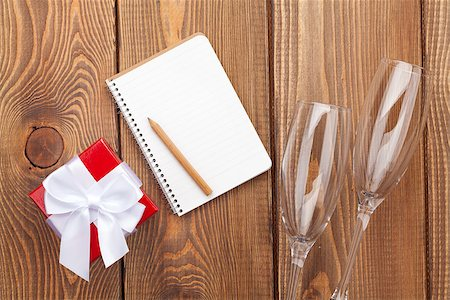 Blank notepad for copy space, valentines day gift box and two champagne glasses over wooden background Stock Photo - Budget Royalty-Free & Subscription, Code: 400-07955445