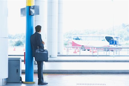 Rear view full body Asian Indian business man waiting bus at public bus station. Stock Photo - Budget Royalty-Free & Subscription, Code: 400-07978346