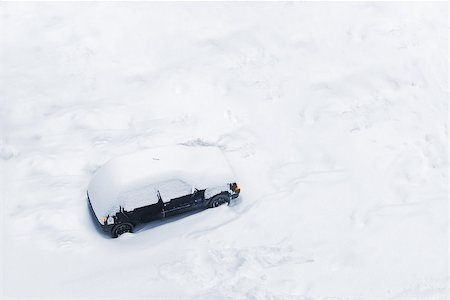 Car Trapped in Deep Snow Build-up after a Blizzard or Big Snow Storm Stock Photo - Budget Royalty-Free & Subscription, Code: 400-07980391