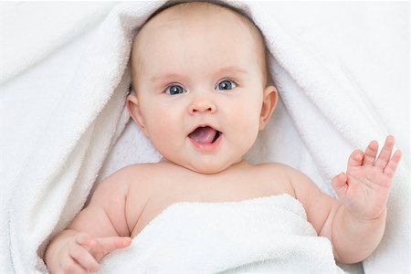 Cute baby portrait lying on bathing towel Stock Photo - Budget Royalty-Free & Subscription, Code: 400-07994986